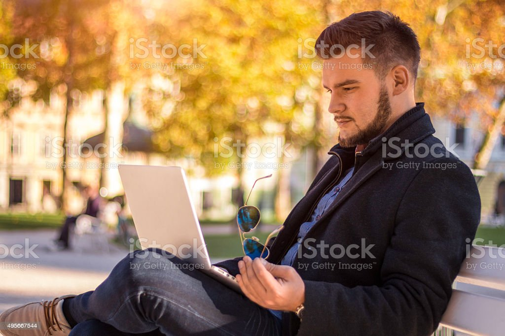 Business using laptop in city stock photo