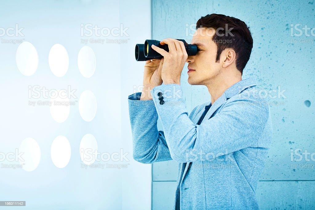 Business vision: man holding binoculars royalty-free stock photo