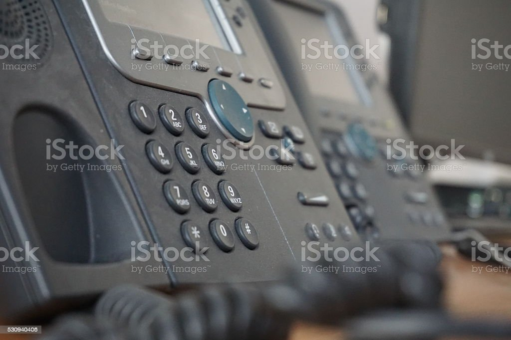 Business wired phone with receiver, dial and large display stock photo