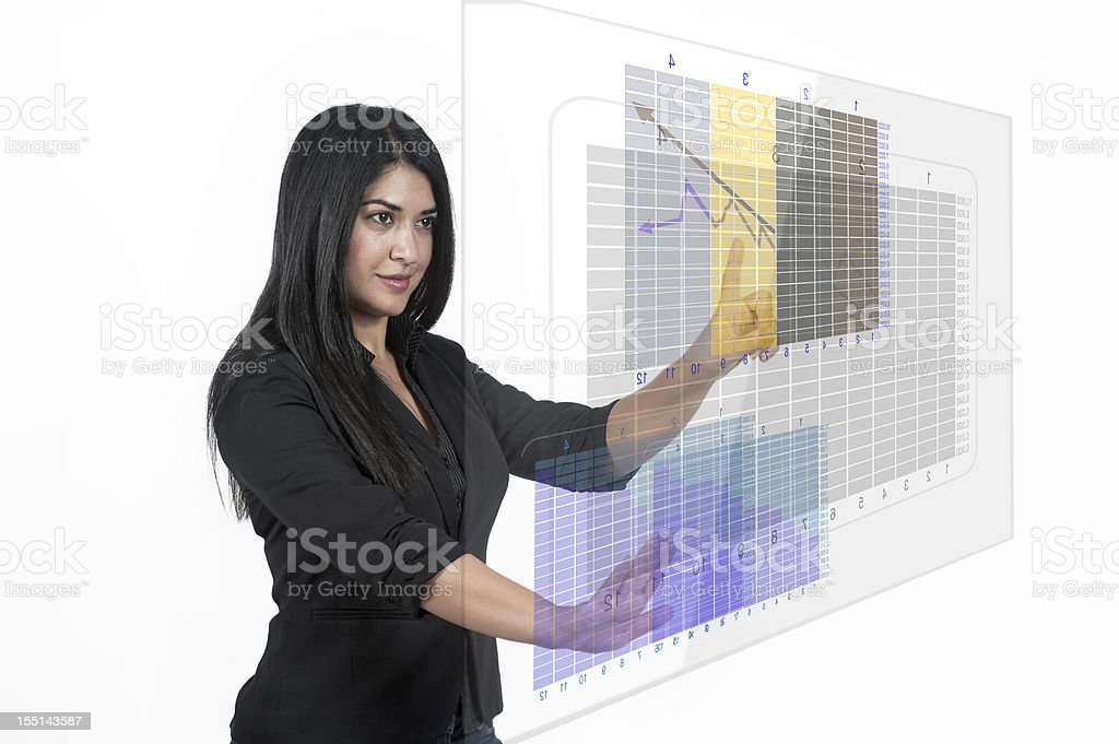 Business Woman Analyzing financial chart on transparent touchscreen stock photo