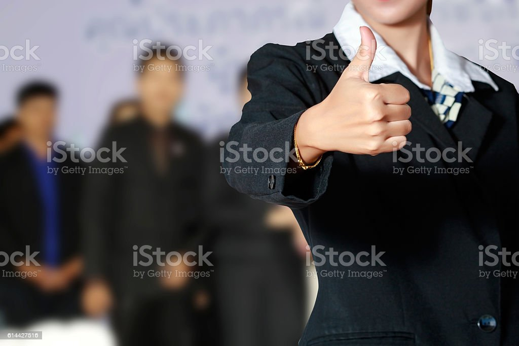 Business woman and business people thump up hand sign stock photo