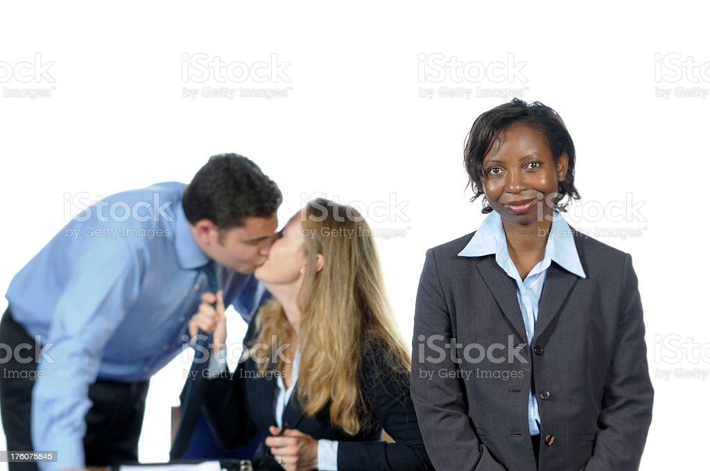 Business Woman and her Team Misbehaving Behind stock photo