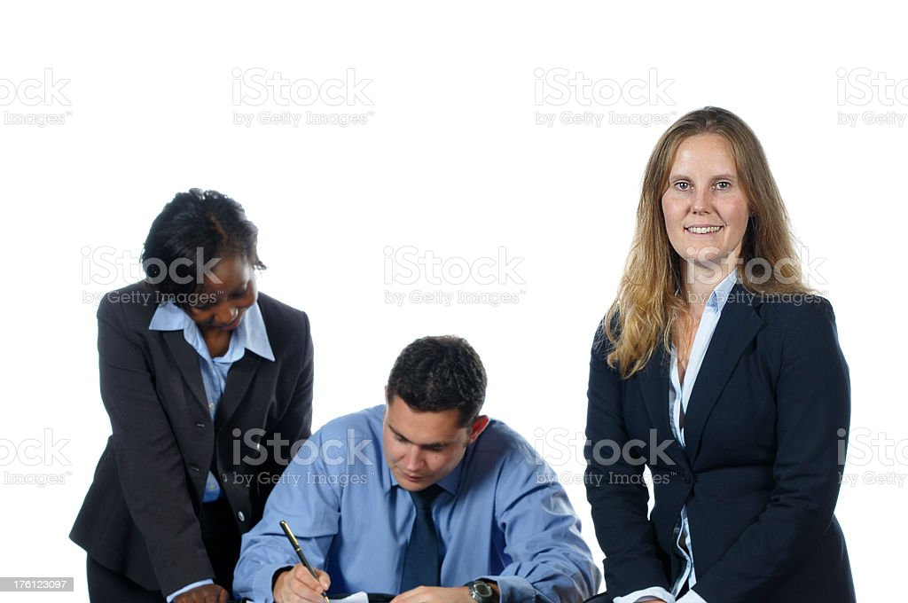 Business Woman and her Team Working Behind stock photo