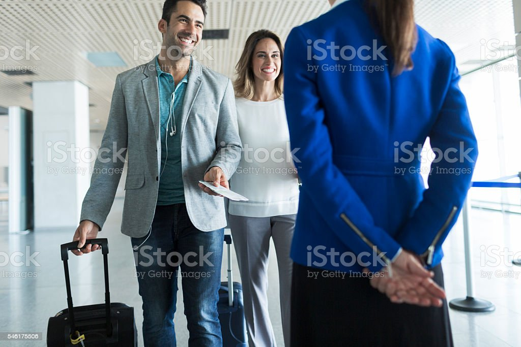 Business woman and man boarding plane. stock photo