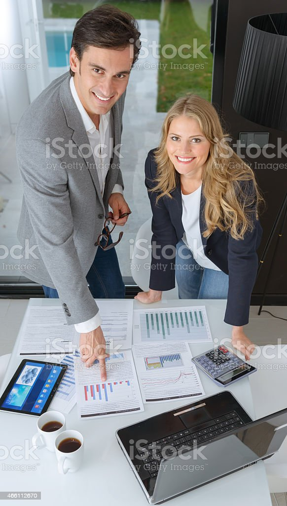 Business woman and man discussing a business plan stock photo