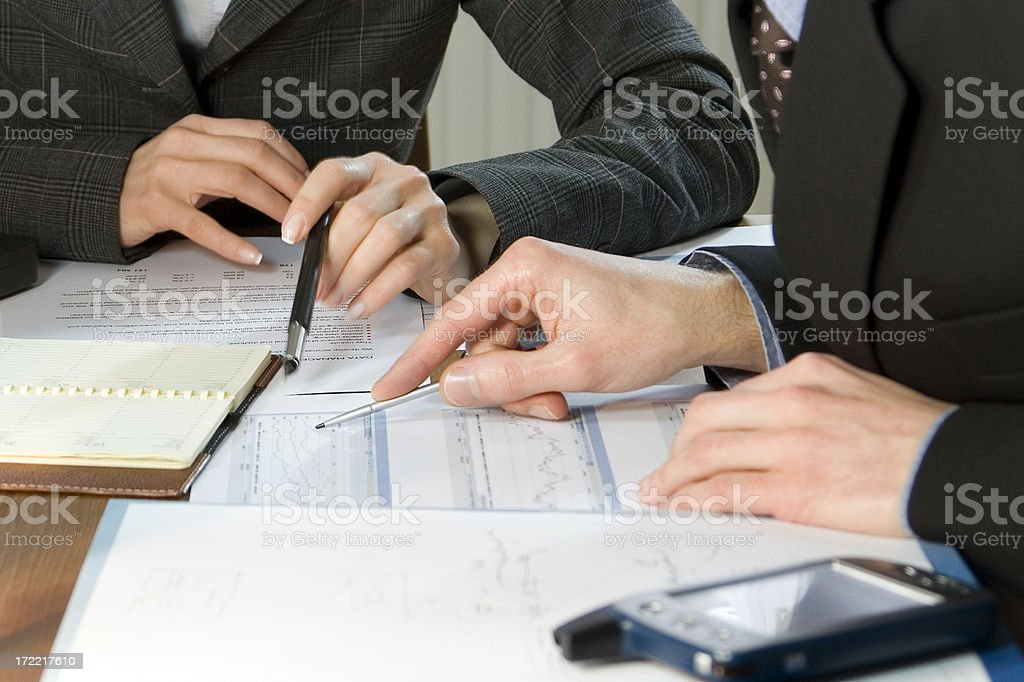 Business woman and man with pens and papers stock photo