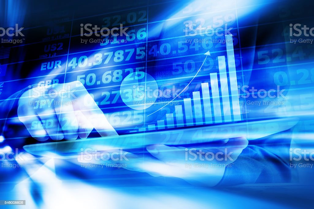 Business woman are checking exchange rates by using digital tabl stock photo