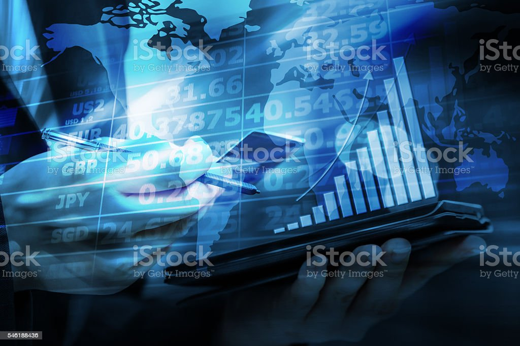 Business woman are checking exchange rates by using mobile phone stock photo