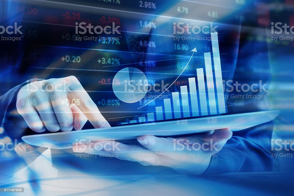 Business woman are checking stock market stock photo