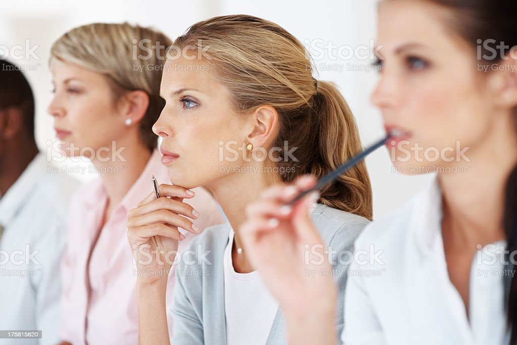 Business woman at a conference paying attention stock photo