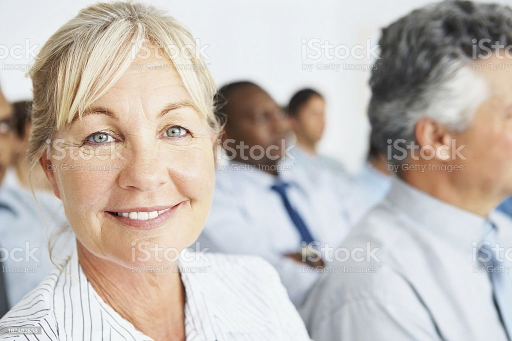 Business woman at a  seminar with colleagues royalty-free stock photo