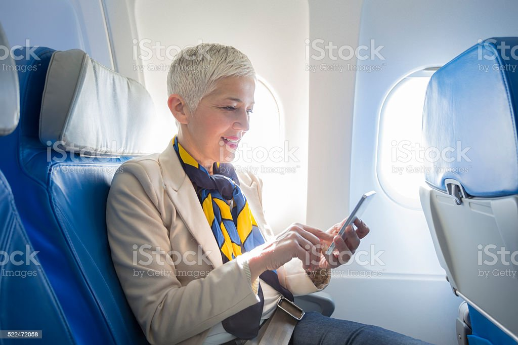 business woman at airplane stock photo