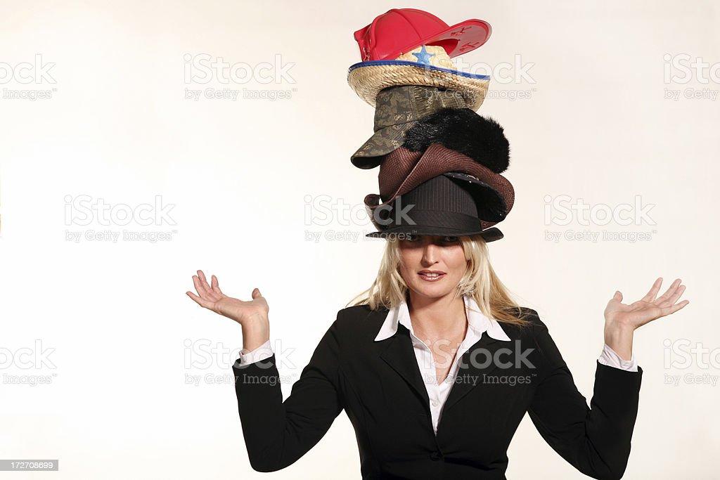 Business woman balancing life having to wear too many hats stock photo