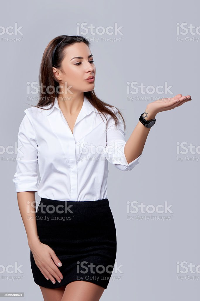 business woman blowing on palm stock photo