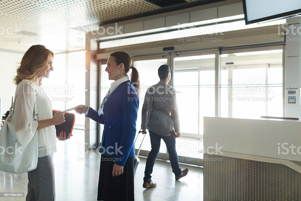 Business woman boarding a plane on departure gate. stock photo