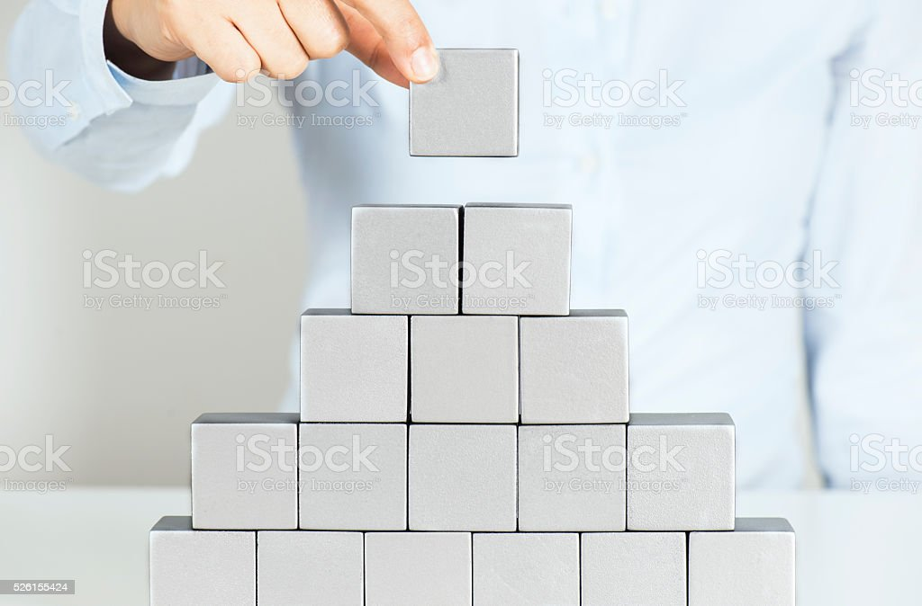 Business woman building a project stock photo