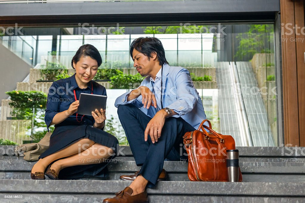 Business woman, business men talking on stairs,Kyoto,Japan stock photo