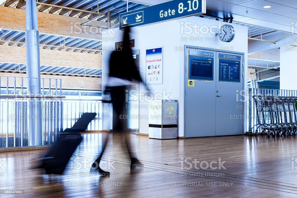 Business woman by airport gate in Billund Denmark stock photo
