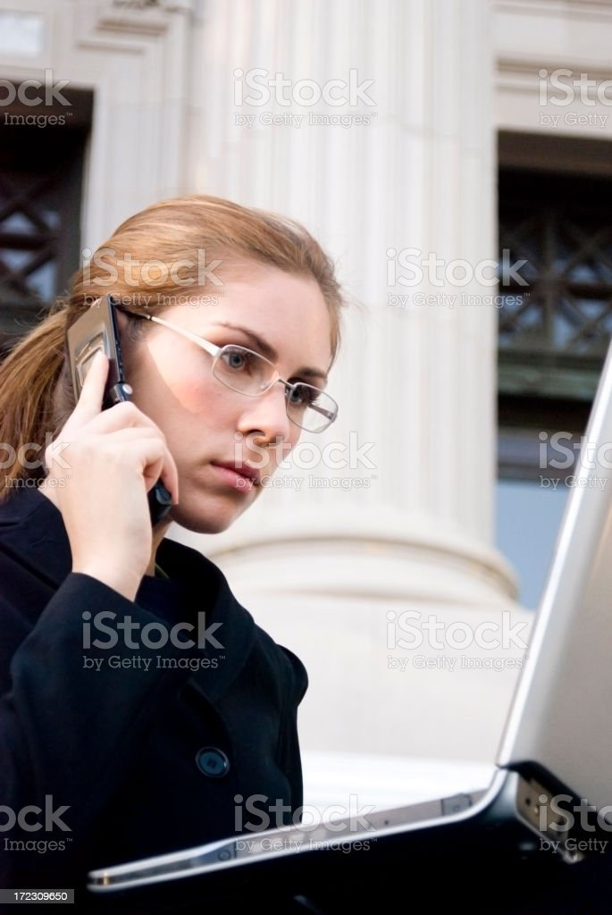 Business woman by columns royalty-free stock photo