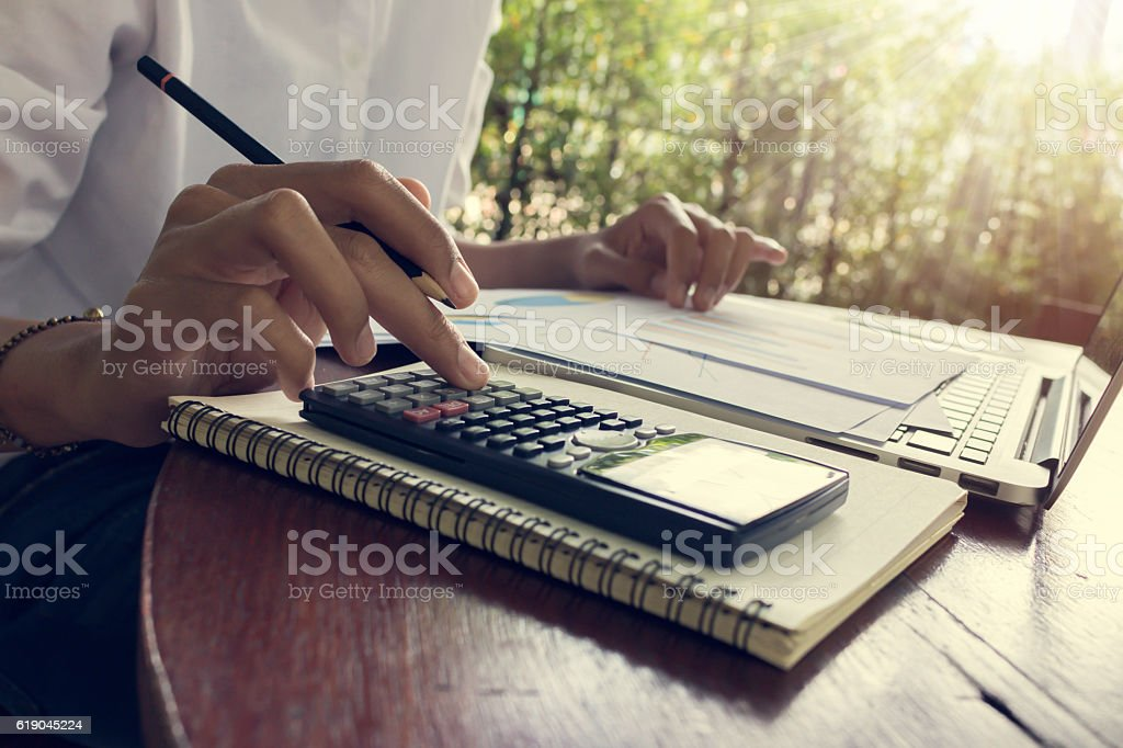 business woman calculate and analyzing graph document financial stock photo