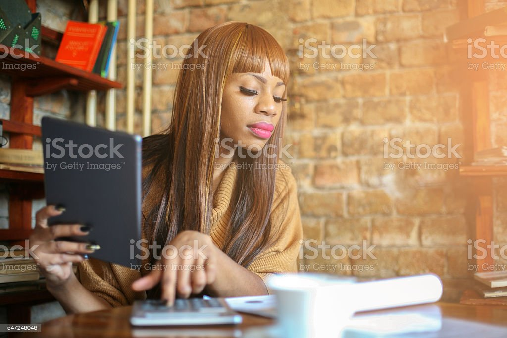 Business woman calculating at work. stock photo