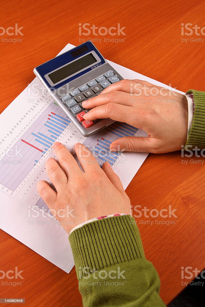 Business woman calculating royalty-free stock photo