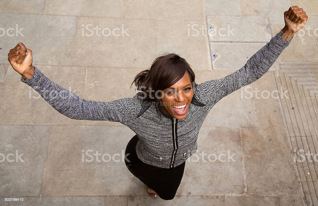 business woman celebrating stock photo