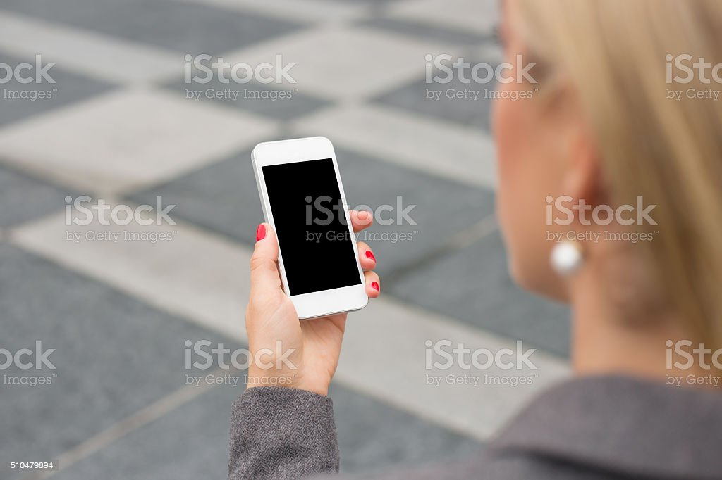 Business woman checking her smartphone stock photo