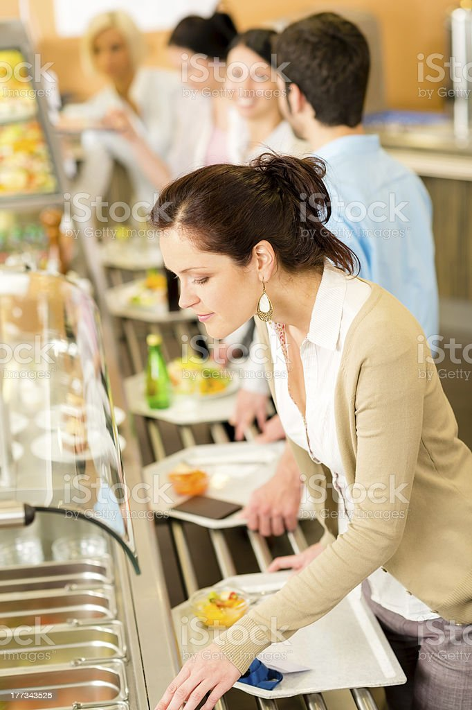 Business woman choose cafeteria lunch buffet stock photo