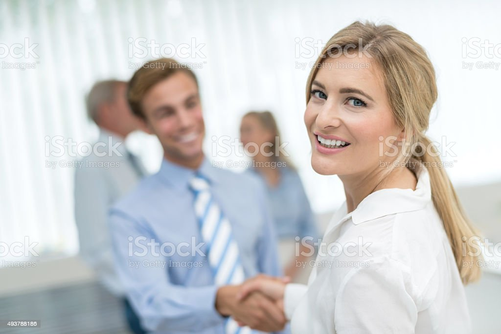 Business woman closing a deal with a handshake stock photo