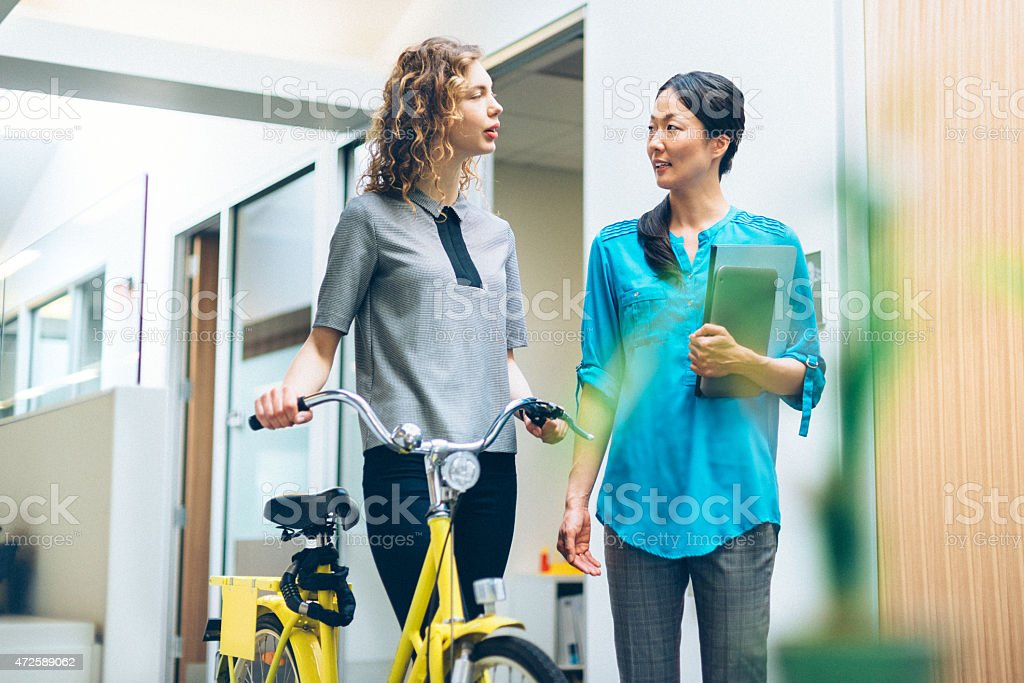 Business Woman Commuting by Bicycle to Work stock photo