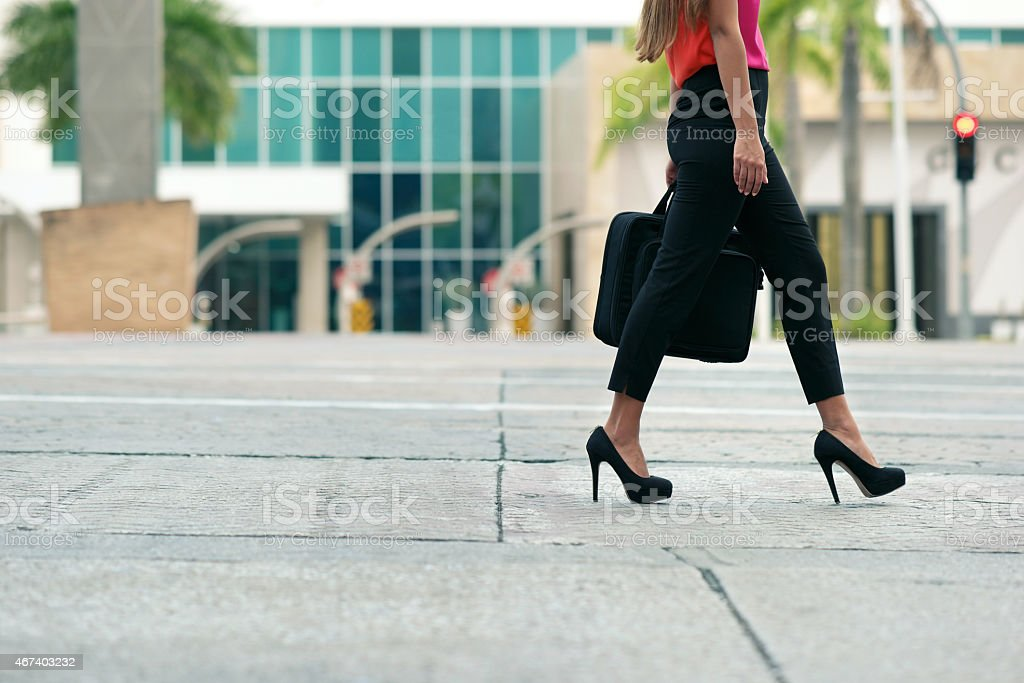 Business woman commuting going to office by walk stock photo