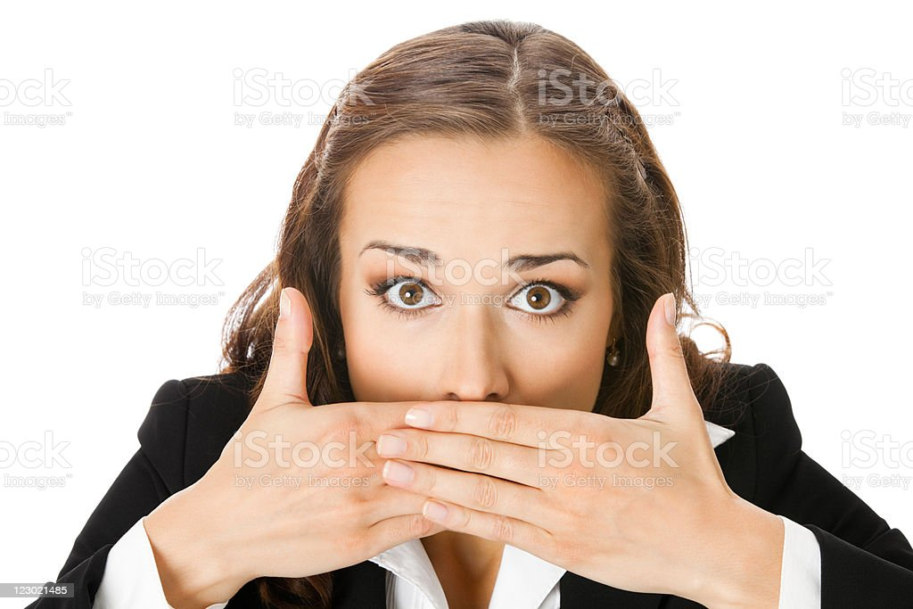 Business woman covering with hands her mouth, isolated stock photo