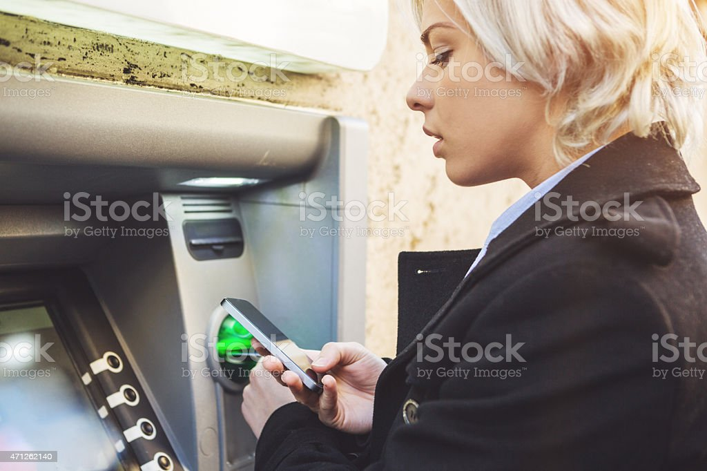 Business woman credit card withdrawal at bank stock photo