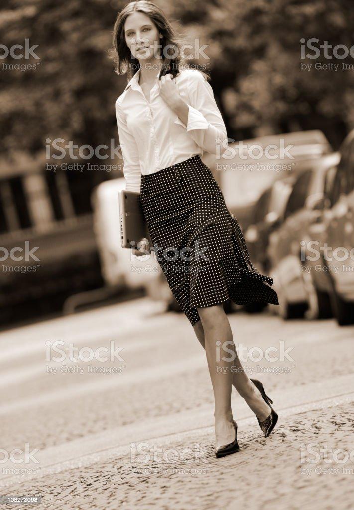 Business Woman crossing a street (XXXL) stock photo