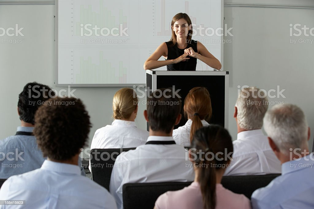 A business woman delivering a presentation royalty-free stock photo