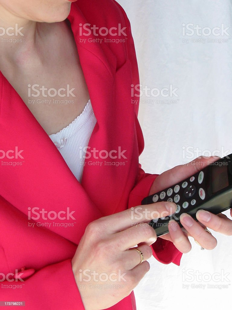 Business - Woman Dialing Cell Phone royalty-free stock photo