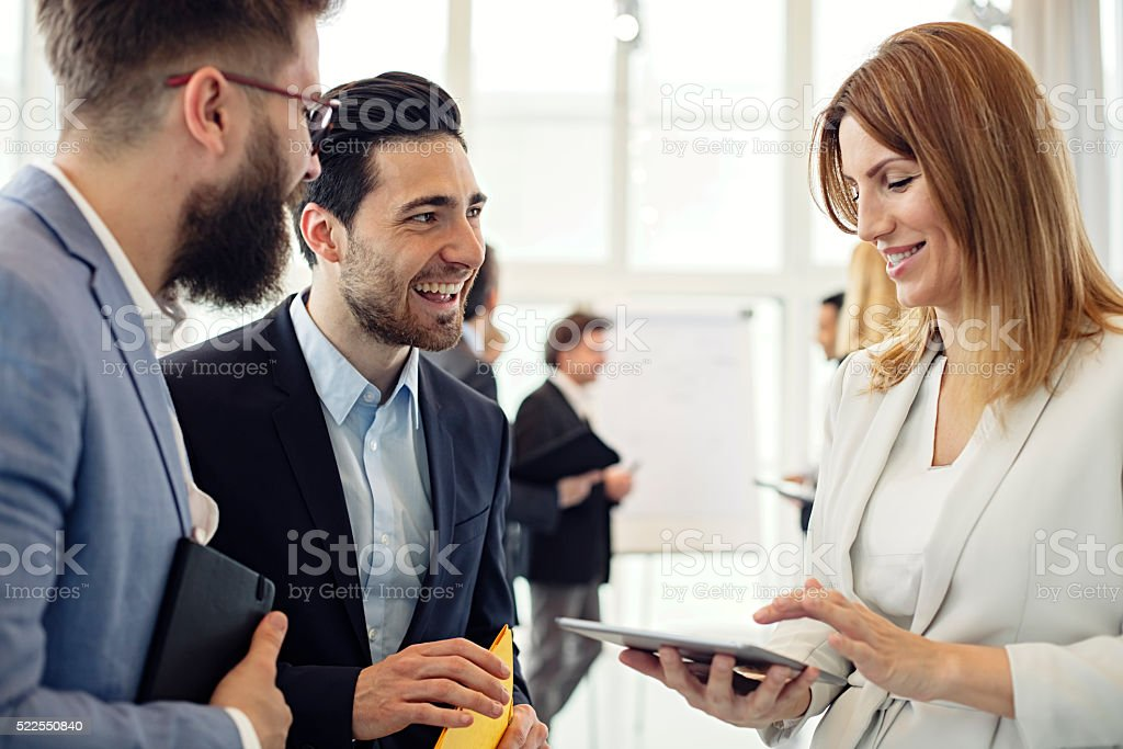 Business woman  discussing project with colleagues in office stock photo