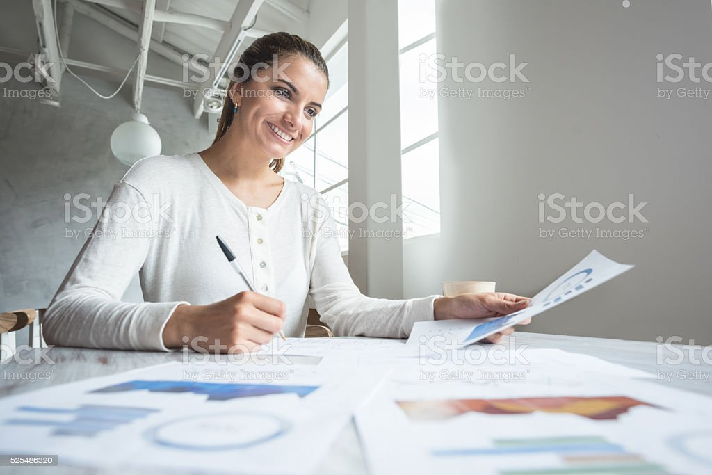 Business woman doing the books at a restaurant stock photo