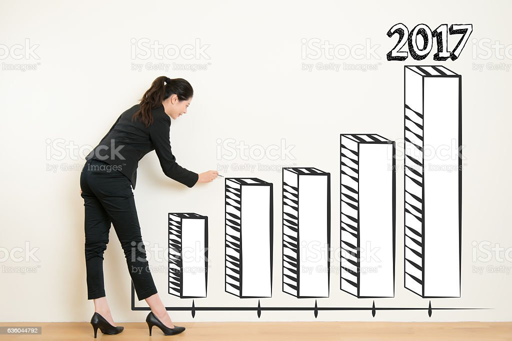 business woman drawing over target achievement graph stock photo