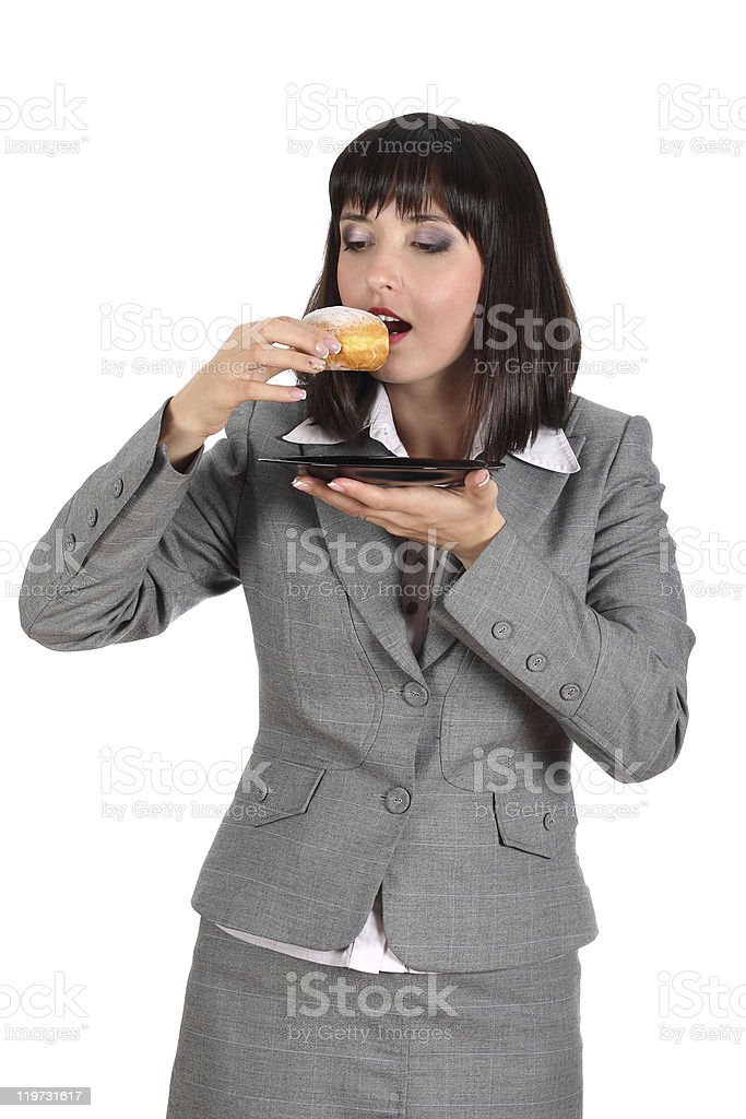 business woman eating donut stock photo