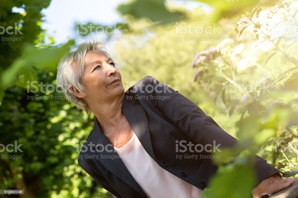 Business woman enjoy the sunshine in the nature stock photo