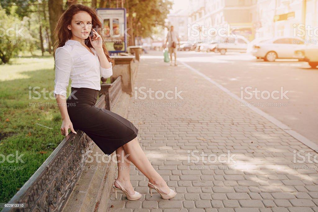 business woman enjoys gadgets stock photo