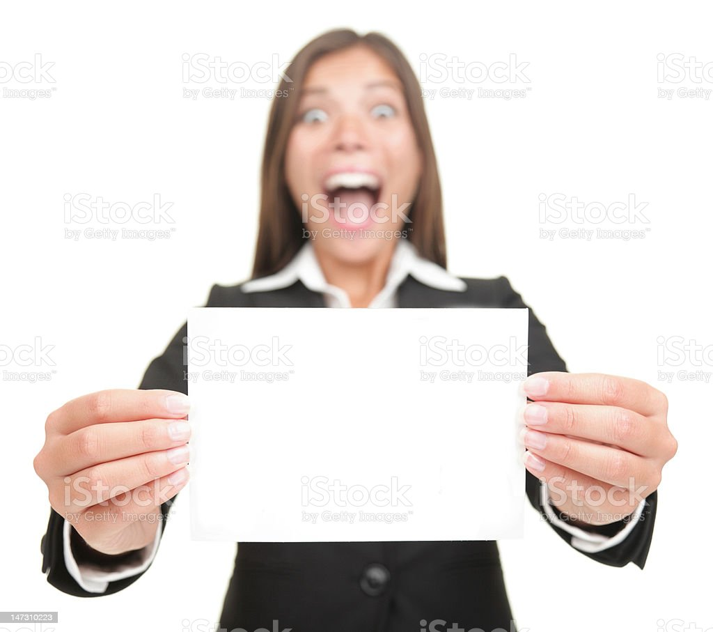Business woman excited holding empty blank sign card stock photo