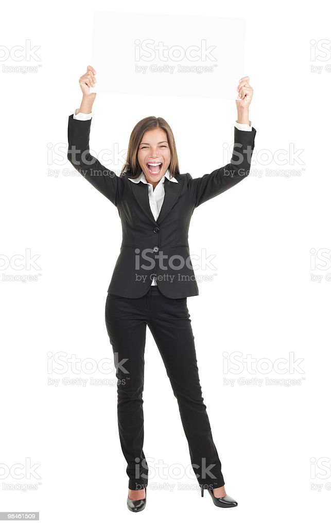 Business woman excited holding white sign stock photo