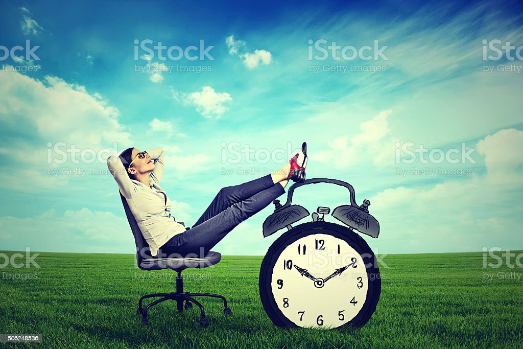 business woman executive relaxing sitting on chair outdoors stock photo