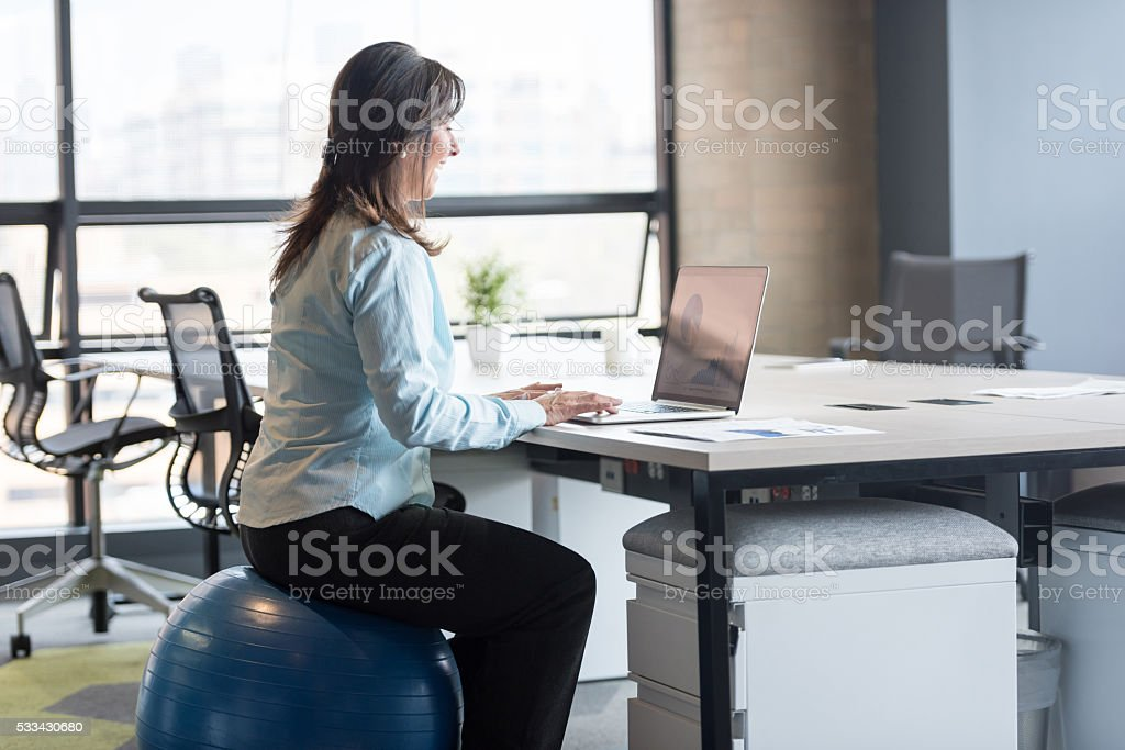 Business woman exercising at the office stock photo