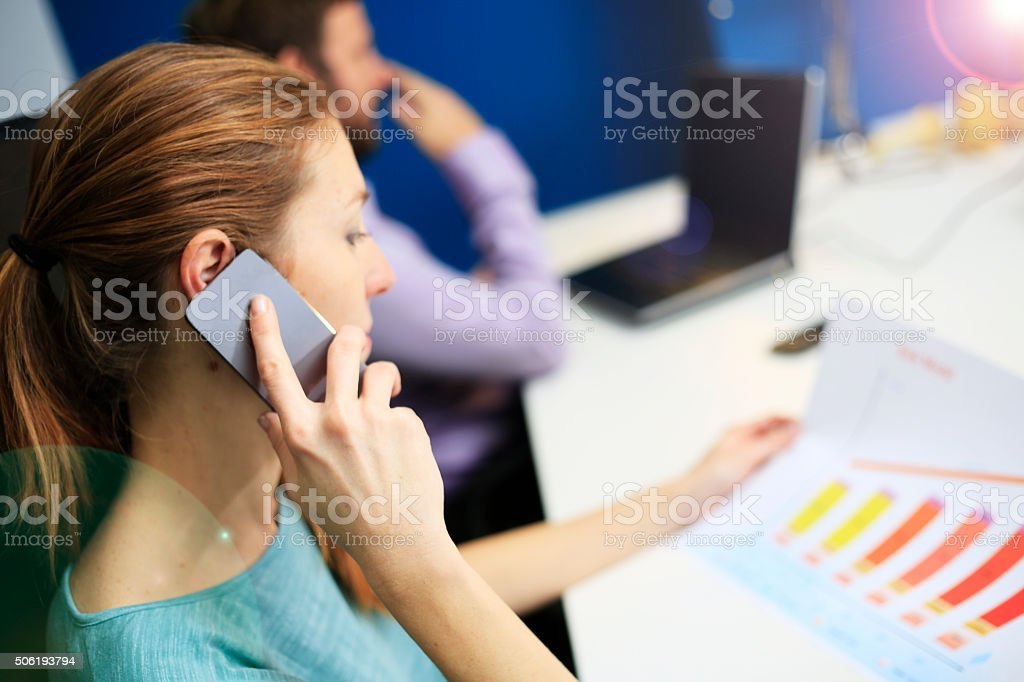 Business woman explains financial report over the phone stock photo