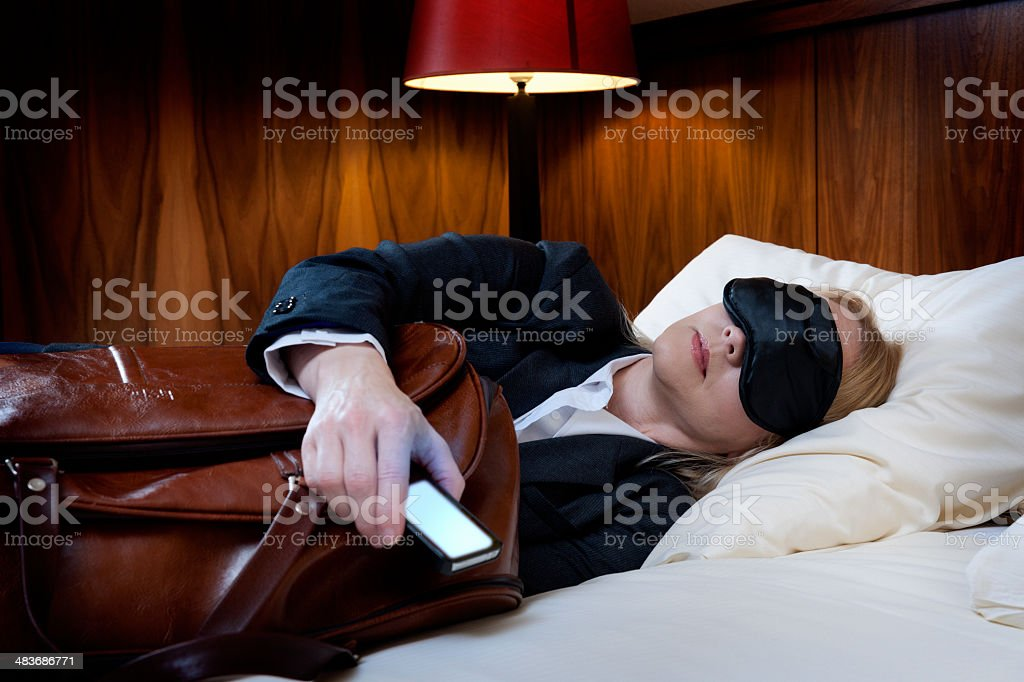 Business woman fallen asleep in the hotel room stock photo