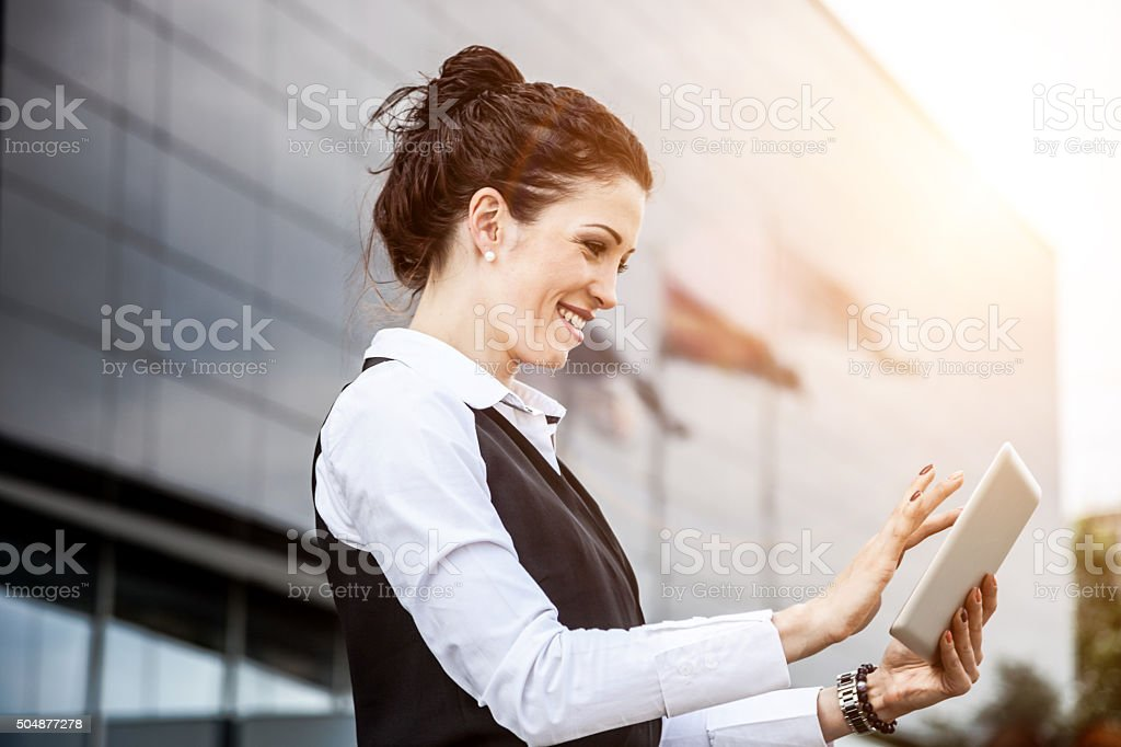 Business woman finalizing tasks on a tablet stock photo